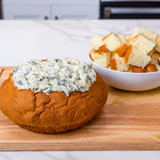 irresistible bread bowl made from King's Hawaiian Original Hawaiian Sweet Round Bread, filled with delicious spinach dip