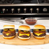 irresistible trio of sweet and tangy bbq pork cheeseburger sliders made with King's Hawaiian Original Sweet Pineapple BBQ Sauce 14.5oz, on King's Hawaiian Original Hawaiian Sweet Slider Buns (Pre Sliced) 9ct