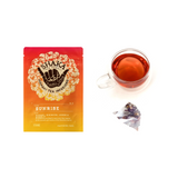 Image of front of packaging for Shaka Tea Sunrise Bag tea and brewed tea cups