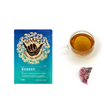 Image of front of packaging for Shaka Tea Sunset Bag tea with Brewed Cup of Tea