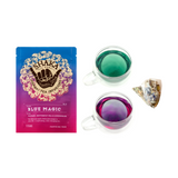 Image of front of packaging for Shaka Tea Blue Magic Bag tea and two colored brewed  hot tea