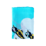 Coco Moon Hawaii Three Little Bird Blue Swaddle folded on white background
