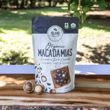 Island Harvest Organic Macadamia Nuts Covered in Dark Chocolate outdoors on wooden surface