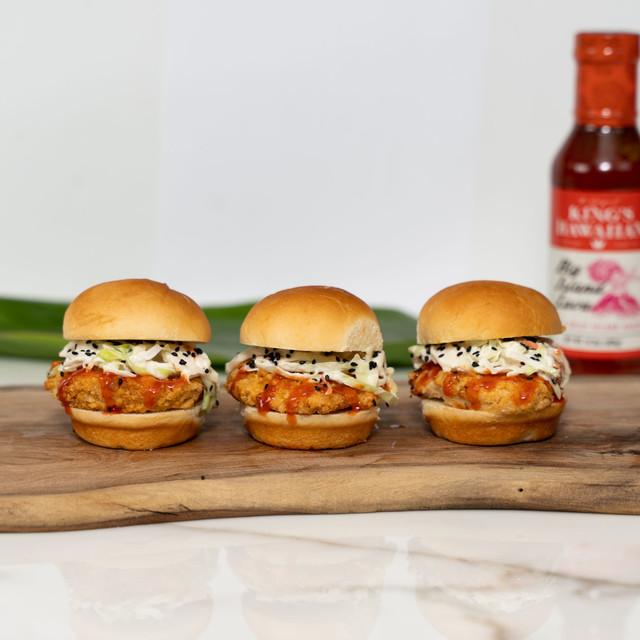 Trio of deliciously irresistible chicken sliders dressed with King's Hawaiian Big Island Lava BBQ Sauce 14.3oz in between King's Hawaiian Original Hawaiian Sweet Slider Buns (Pre Sliced) 9ct