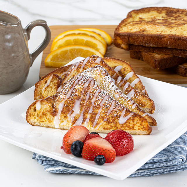irresistible King's Hawaiian Coconut Syrup Mix 4oz drizzled over mouthwatering french toast made with King's Hawaiian Original Hawaiian Sweet Sliced Bread 12oz