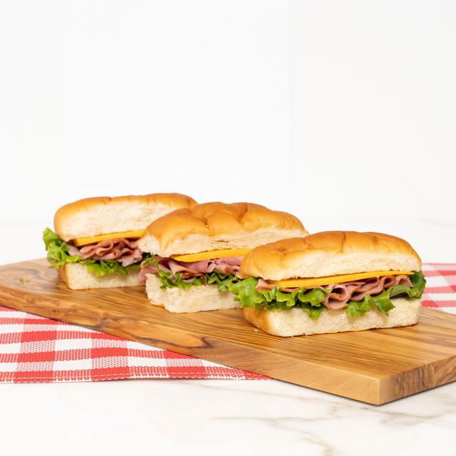 Trio of delicious ham and cheese sandwiches made with King's Hawaiian Original Hawaiian Sweet Mini Sub Rolls 6ct