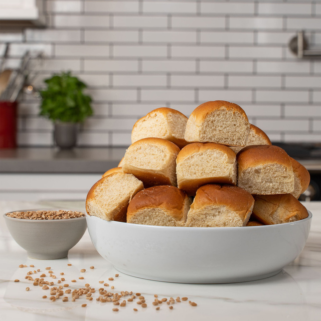 irresistible bowl piled high with 12 delicious King's Hawaiian Honey Wheat Rolls