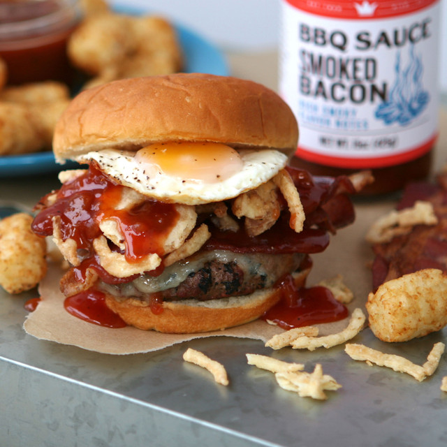 Juicy and irresistible BBQ burger topped with fried onions, fried egg, and King's Hawaiian Smoked Bacon BBQ Sauce 14.8oz