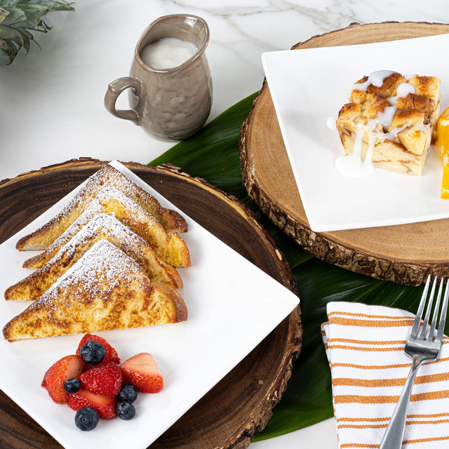 irresistible plates of bread pudding and french toast made with King's Hawaiian Original Hawaiian Sweet Sliced Bread 1lb, Creamy Coconut Bread Pudding Mix 8oz, French Toast Batter Mix 8oz, and Coconut Syrup Mix 4oz