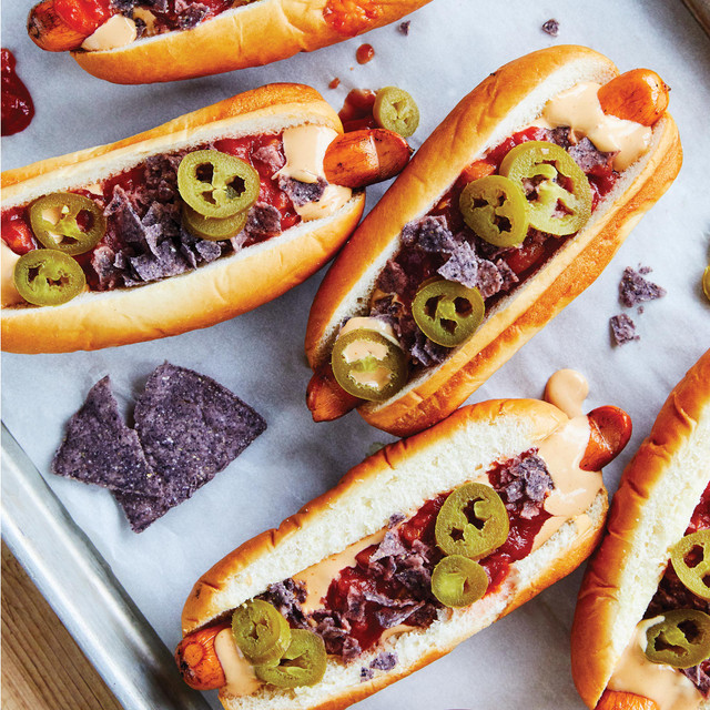 hotdog sandwiches topped with jalapeno and crushed chips