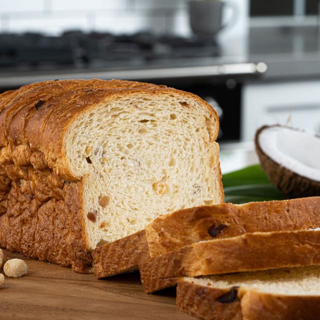 Fresh loaf of King's Hawaiian Coconut Macadamia Nut Sliced Bread 1lb, baked with real Hawaiian Macadamia nuts and premium coconut flakes