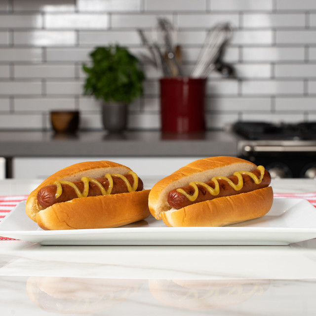 Two irresistible hot dogs nestled in fluffy King's Hawaiian Original Hawaiian Sweet Hot Dog Buns 8ct