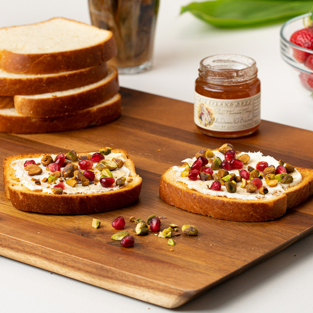 irresistible slices of King's Hawaiian Original Hawaiian Sweet Sliced Bread topped with fruits, nuts, and drizzled with Macadamia Nut Blossom Honey 9oz