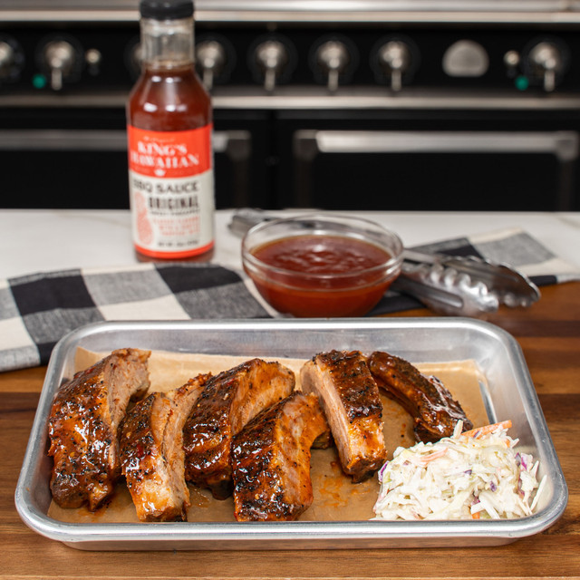 Delicous rack of ribs slathered with King's Hawaiian Original Sweet Pineapple BBQ Sauce 14.5oz