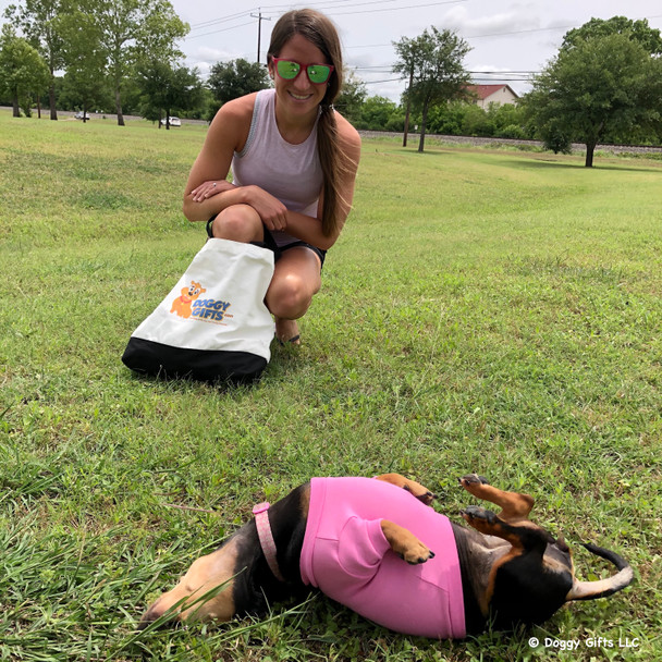 Sadie the mini dachshund loves a roll on the grass and wears her Life Is Good® doggy tee shirt