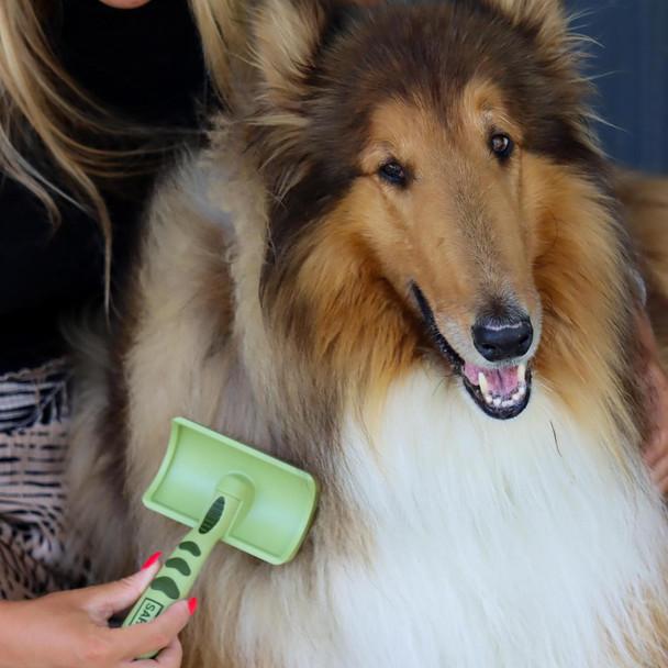 Safari® Curved Firm Slicker Long Hair Dog Brush in use