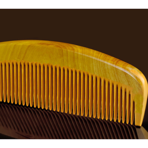 Japanese tsuge wood comb with smooth, seamless, anti-static teeth.