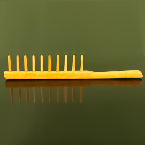 Sleek and sophisticated detangler brush. Handcrafted from tsuge (Boxwood).