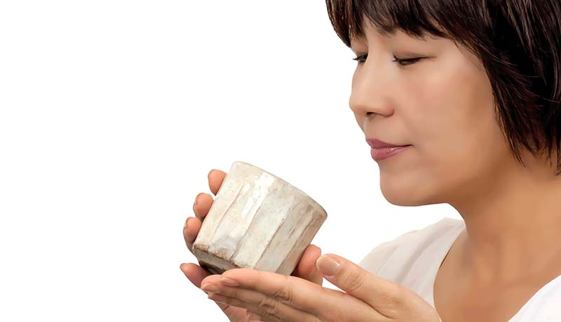 Japanese woman drinking a cup of tea