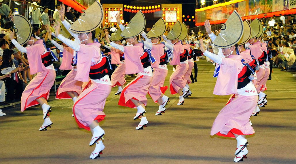 Awa odori dancers in tight, colorful kimonos