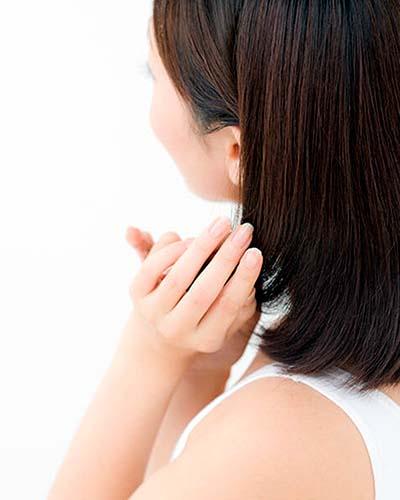 Japanese woman caressing hair