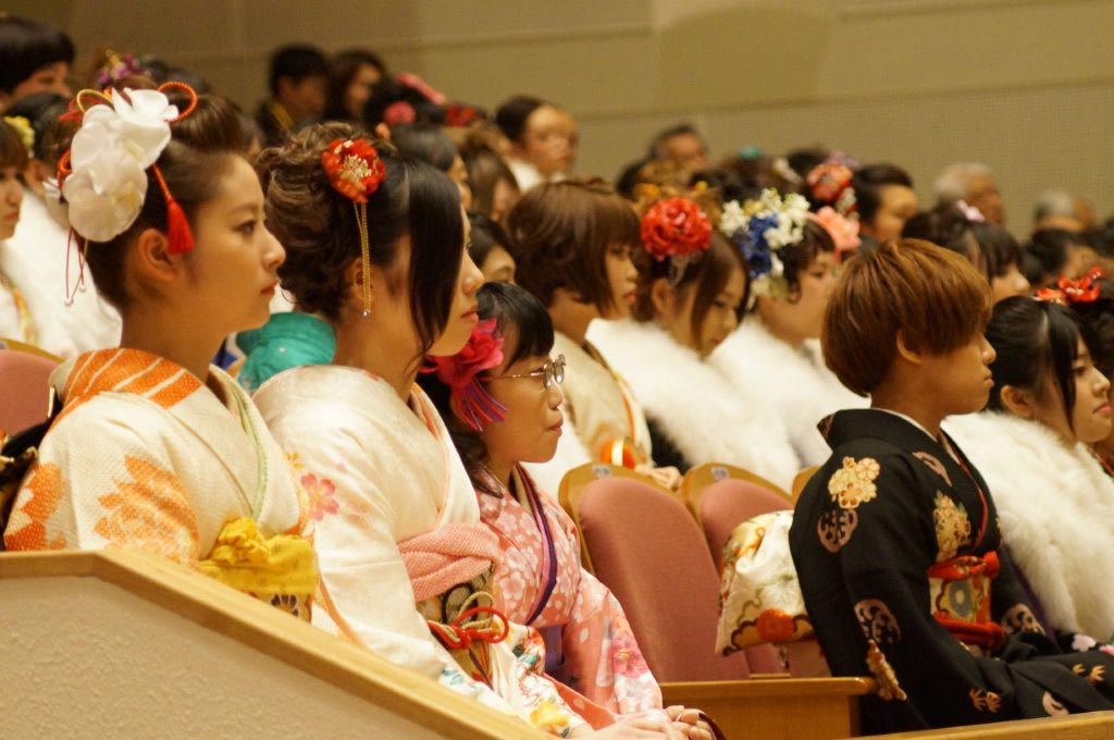 Young Japanese listening to speech