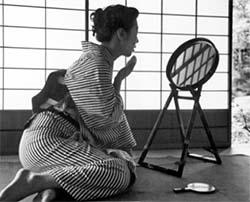 Japanese woman in kimono sitting on floor
