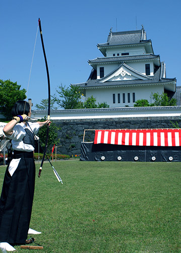 Japanese woman practicing kyudo archery in Amagajo castle