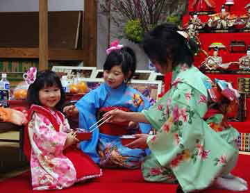 Kimono-clad mother and two daughters