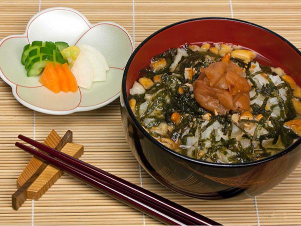 ochazuke, pickles and chopsticks over a bamboo matt