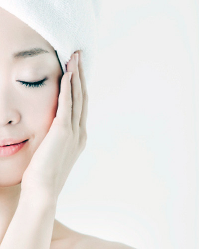 Japanese woman caring for her skin