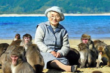 Satsue Mito with her monkeys in Kojima, Miyazaki