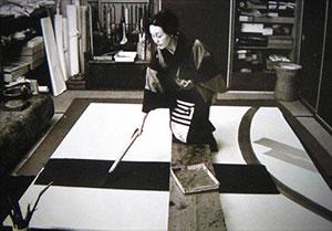 Toko Shinoda painting sumi-e in her twenties