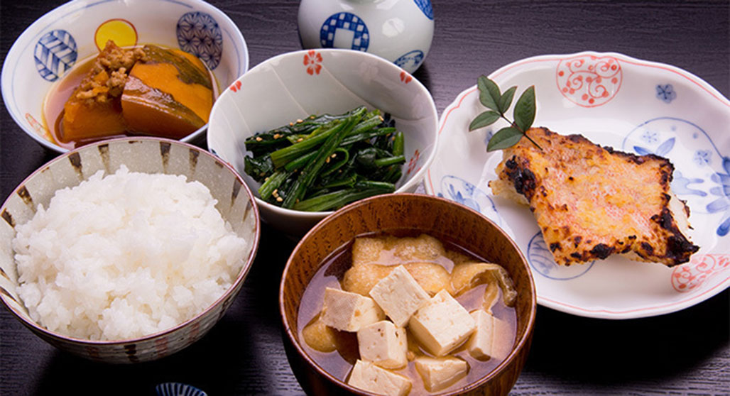 Typical Japanese meal of one bowl of rice, one bowl of soup, one main dish and two side dishes