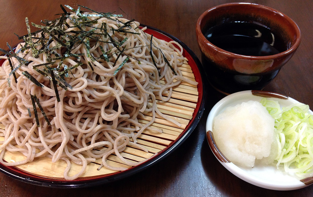 Chilled noodles served with a cold broth called tsuyu on a bamboo tray