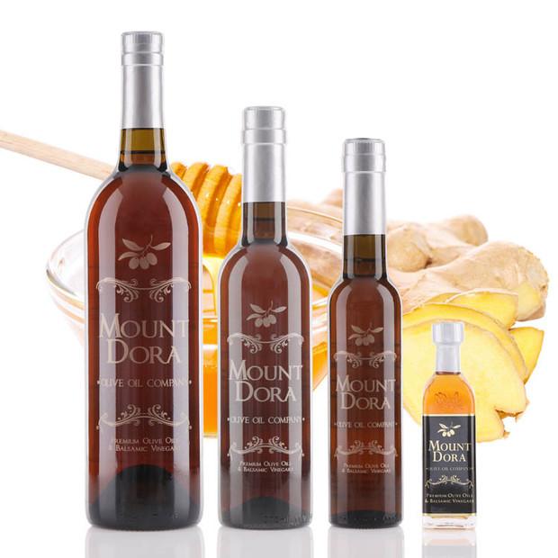 Four different size bottles of Mount Dora Honey Ginger White Balsamic Vinegar