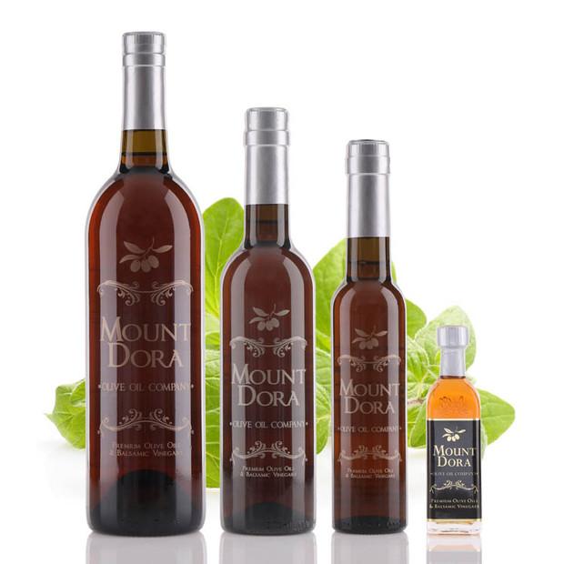Four different size bottles of Mount Dora Oregano White Balsamic Vinegar
