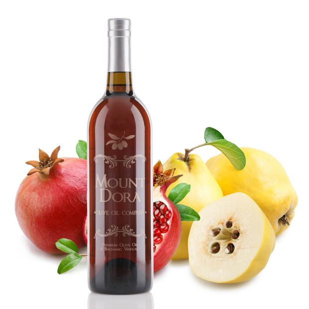 A 750mL bottle of Tarpon Springs  Pomegranate Quince White Balsamic Vinegar