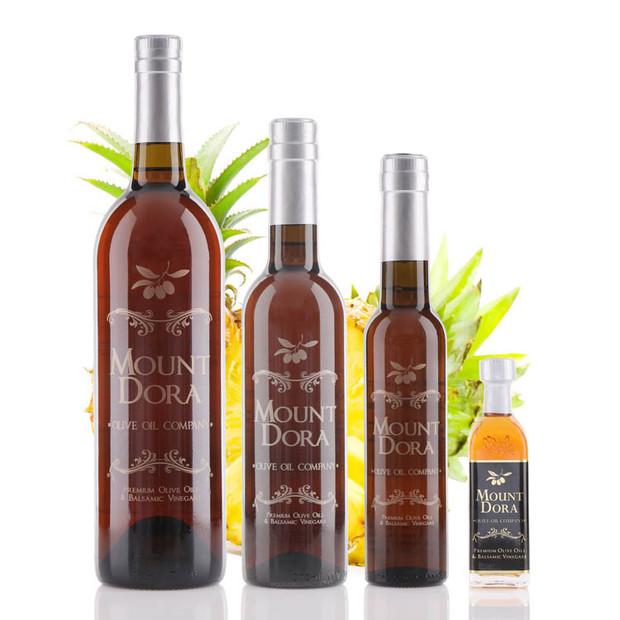 Four different size bottles of Mount Dora Golden Pineapple White Balsamic Vinegar