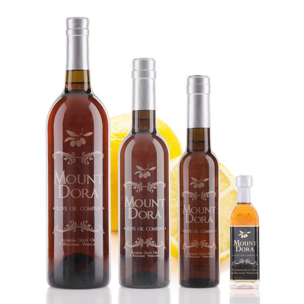 Four different size bottles of Mount Dora Sicilian Lemon White Balsamic Vinegar