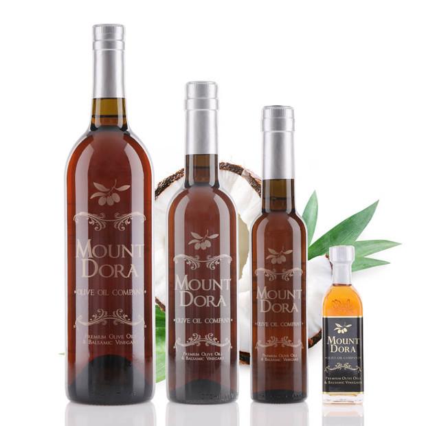 Four different size bottle of Mount Dora Coconut White Balsamic Vinegar