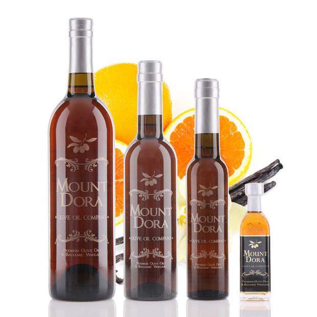 Four different size bottles of Mount Dora Cara-Cara Orange Vanilla White Balsamic Vinegar