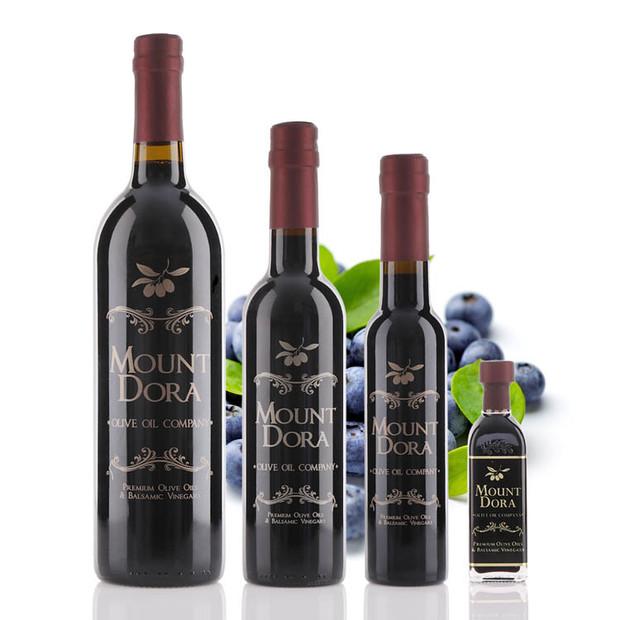 Four different size bottles of Mount Dora Wild Blueberry Dark Balsamic Vinegar