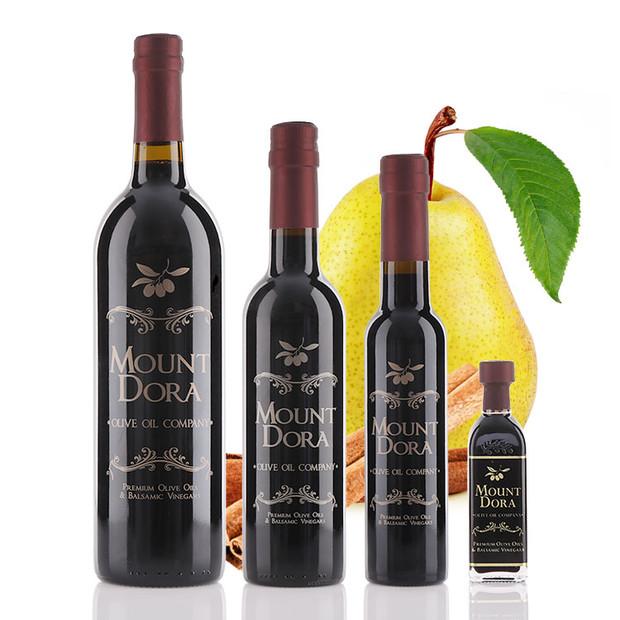 Four different size bottles of Mount Dora Cinnamon Pear Dark Balsamic Vinegar