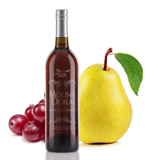 Four different size bottles of Mount Dora Cranberry Pear White Balsamic Vinegar