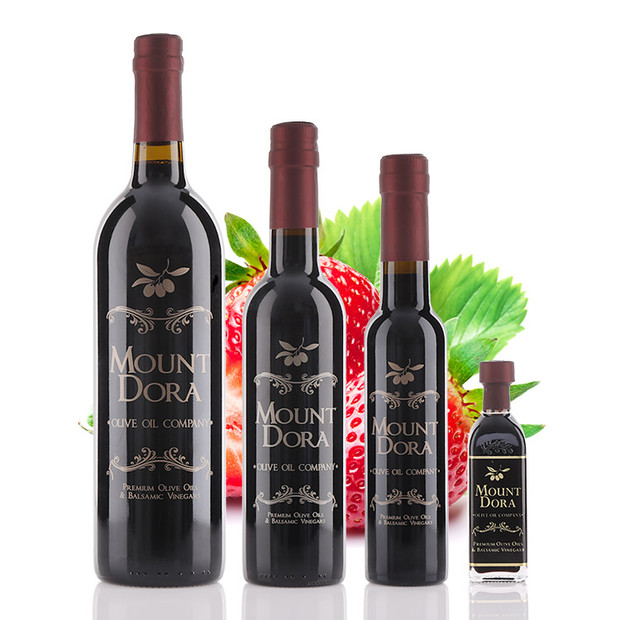 Four different size bottles of Mount Dora Strawberry Dark Balsamic Vinegar