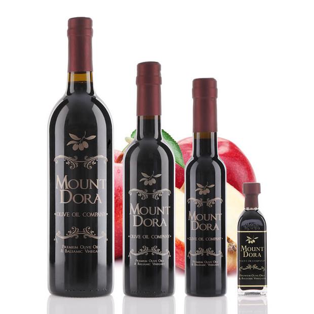 Four different size bottles of Mount Dora Red Apple Dark Balsamic Vinegar