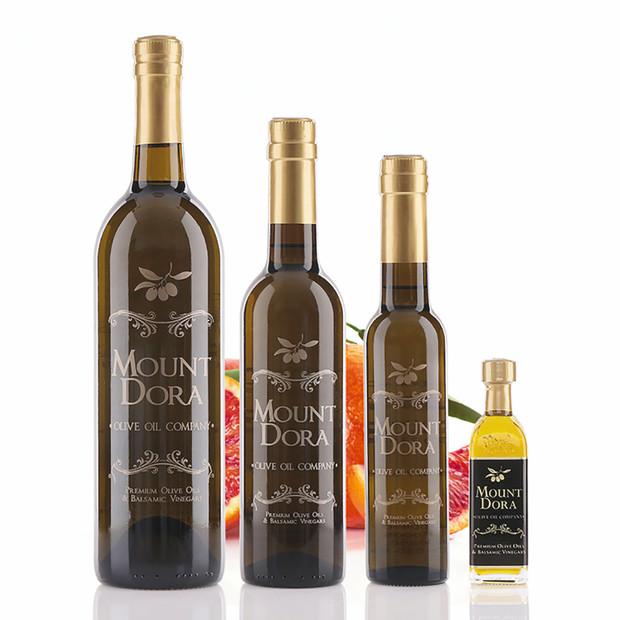 Four different size bottles of Mount Dora Blood Orange Fused Olive Oil