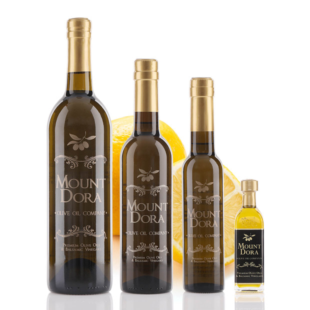 Four different size bottles of Mount Dora Eureka Lemon Infused Olive Oil