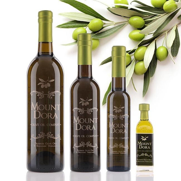 Four different size bottles of Mount Dora Australian Hojiblanca Extra Virgin Olive Oil